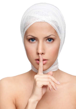 facelift: Keeping a secret of a facelift, isolated, white background Stock Photo