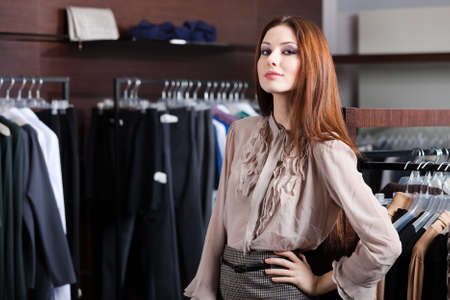 Lovely woman is in the shopping center photo
