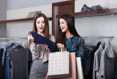 Two young attractive girlfriends go shopping photo