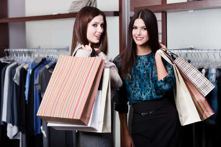 boutiques: Two friends are in the store with grate sales