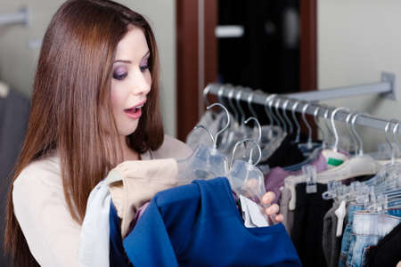 Young woman is amazed with sale in this shop Stock Photo - 14847488