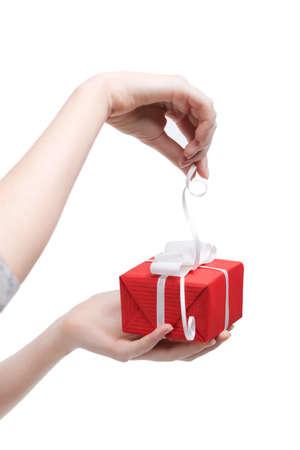 Gift opening, isolated on white photo