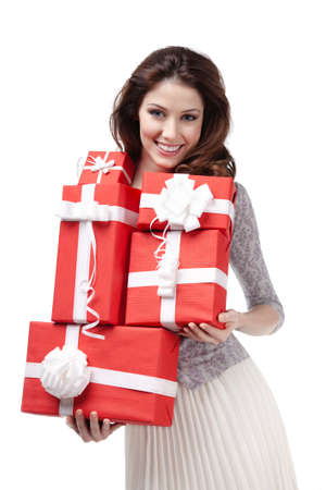 Pretty woman hands many presents wrapped in red paper, isolated on white photo