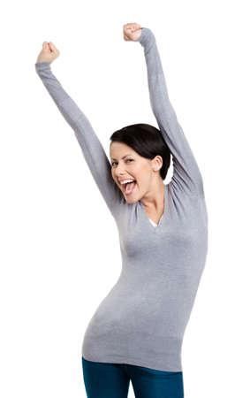 gladly: Hermosa chica gestos triunfales pu�os pone sus manos en alto, aislado en blanco