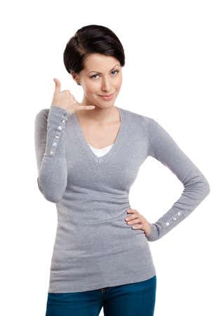 gladly: Sonriente ni�a hace un gesto de llamada de tel�fono, aislado en blanco Foto de archivo