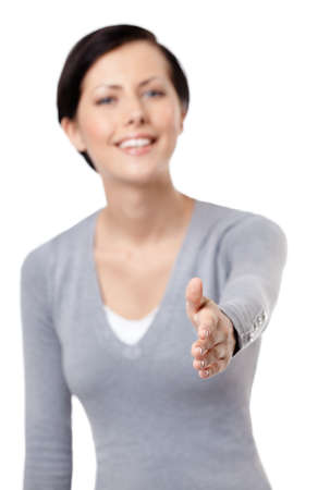 Hand shake gesture, isolated on white, fuzzy background photo