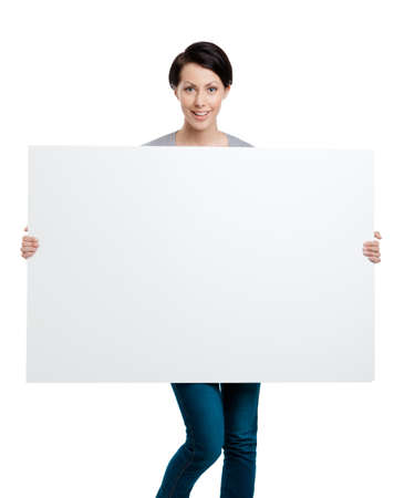 Girl carries a huge sheet of white cardboard , isolated on white Stock Photo - 14847422