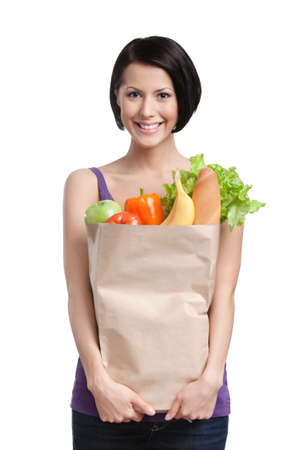 Smart girl with the packet of fruit and vegetables, Isolated, white background. Healthy food photo