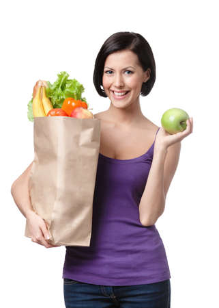 Pretty young woman with the packet full of different healthy food, isolated, white background - diet concept photo