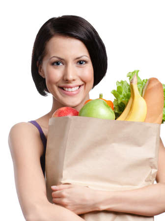 Attractive girl with the packet of fruit and vegetables, Isolated, white background. Health improving photo
