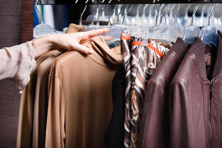 choosing clothes: Choosing a piece of clothing, close up