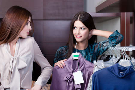 decide deciding: Friends give pieces of advice to each other concerning the clothes
