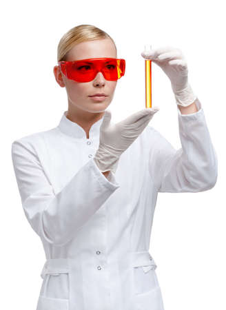 researchers: Woman doctor in glasses hands vial, isolated on white