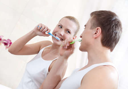 Husband and wife brush teeth in bathroom Stock Photo - 14864744