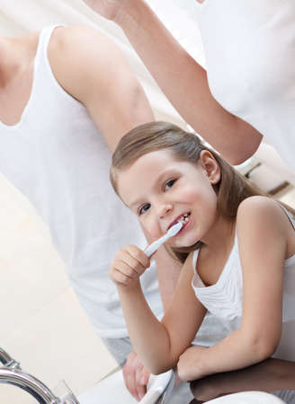 Little girl brushes her teeth in bathroom Stock Photo - 14863593