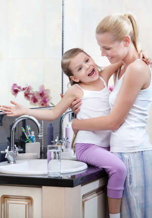 fond of children: Mum and daughter are in bathroom