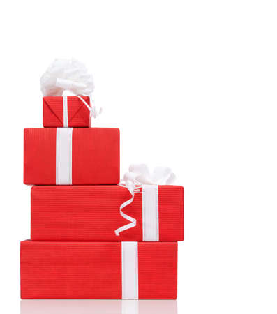 festive occasions: Pillar of boxes with presents wrapped in red paper, isolated on white Stock Photo