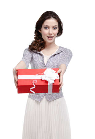 Extend: Young woman hands a gift wrapped in red paper, isolated on white Stock Photo