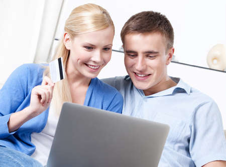 Married couple makes purchases on the internet photo