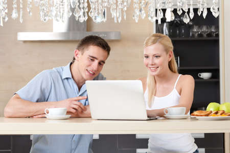 Having breakfast married couple surfs on the internet Stock Photo - 14865566