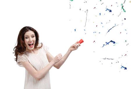 petardo: Aplaude la mujer confeti, aislado en blanco Foto de archivo