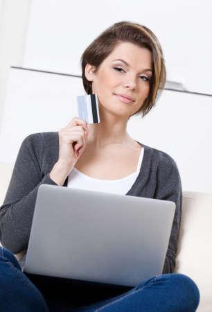 Woman makes bargains through the internet photo