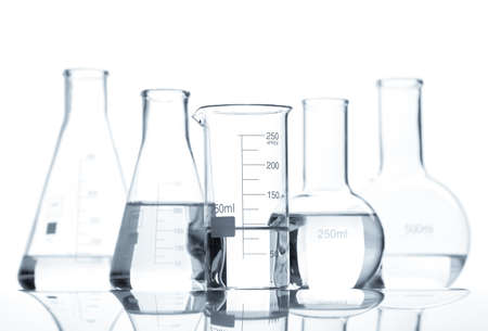 Five classic laboratory flasks with a clear liquid, isolated