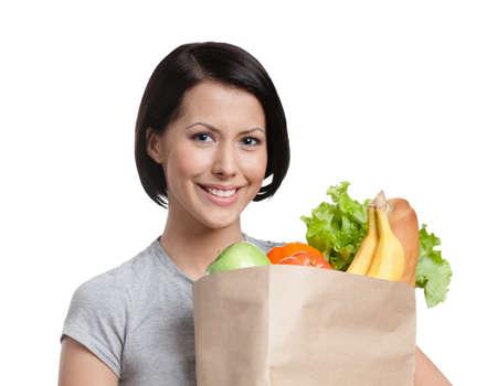 mental object: Smiley ni�a mantiene el paquete de verduras, aislado, fondo blanco