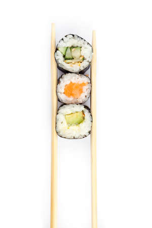 Row of sushi rolls with chopsticks, isolated