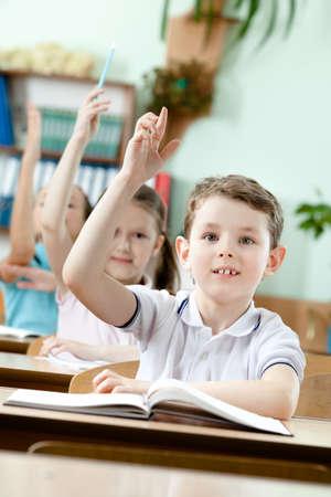 Pupils put their hands upward Stock Photo - 14865428