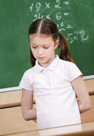 hands behind back: Pupil doesnt know the answer and she is ashamed of it. She puts her hands behind the back