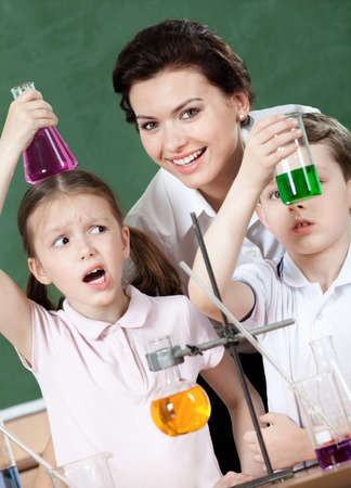 Little pupils wonder at the result of the chemical experiment Stock Photo - 14866042