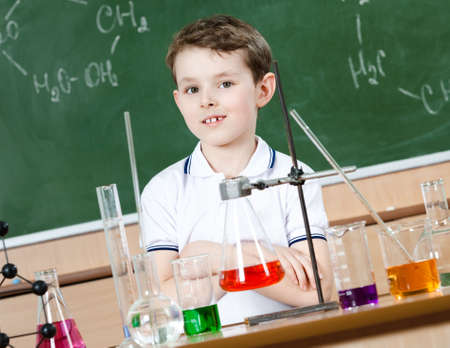 Little chemist is going to hold an experiment at chemistry class Stock Photo - 14864966