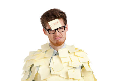 Young man with a sticky note on his face, covered with yellow sticky notes, isolated on white background on white photo