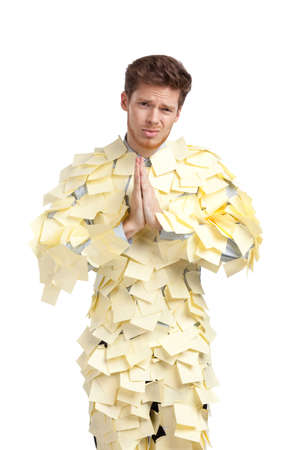 The young man covered with yellow sticky notes, isolated on white background photo