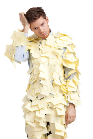 assert: The young man covered with yellow stickers, isolated on white background