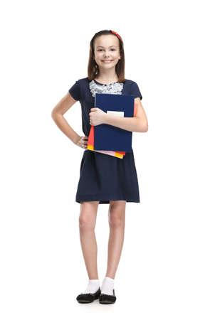 schoolgirl uniform: Schoolgirl keeps her books, isolated, white background