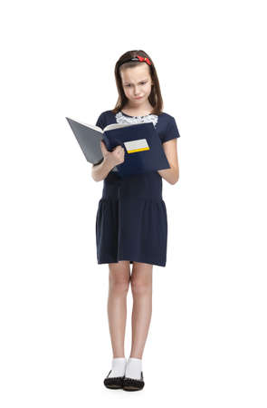 Thoughtful schoolgirl carries her books, isolated, white background photo