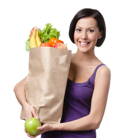 Pretty young woman with the packet full of different healthy nutrition, isolated, white background photo