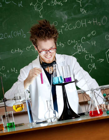 chemically: Mad professor holds a vial with red liquid