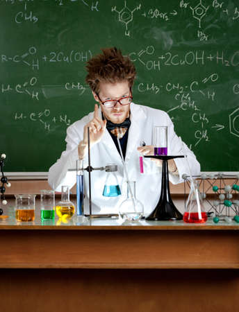 mad scientist: Mad professor shows attention gesture in his laboratory Stock Photo