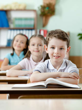 vertical format: Pupils are very attentive at classes. They listen to every word of teacher