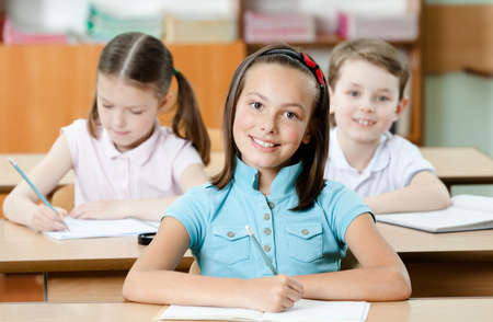 schoolhouse: Pupils are are glad to study. They listen to every word of teacher Stock Photo