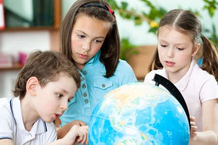 pry: Pupils stare at the school terrestrial globe