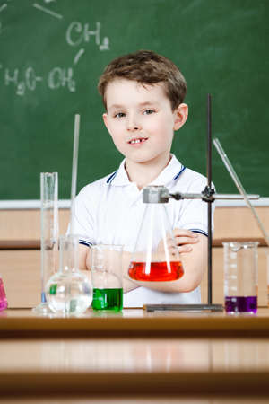 Little chemist holds an experiment Stock Photo - 14980397
