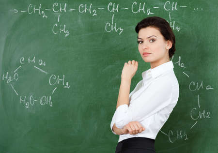 stinks: Smiley teacher at the chalkboard writes a chemical formula