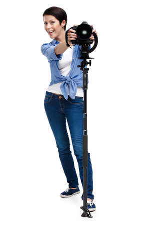Woman is ready to take pictures holding photographic camera, isolated on white photo