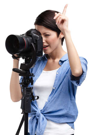 Woman takes snaps holding photographic camera, isolated on white photo