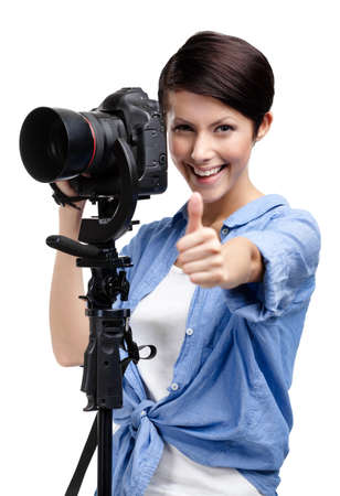 Woman takes photos holding photographic camera, isolated on a white Stock Photo - 14980365