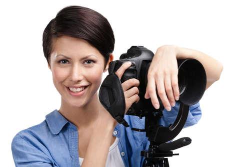 Woman takes photos holding photographic camera, isolated on white Stock Photo - 14980375